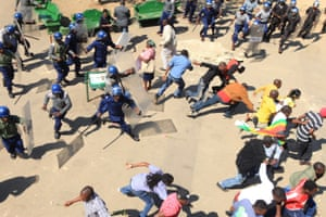 Riot police clash with protesters during a demonstration against the introduction of bond notes by the Reserve Bank of Zimbabwe