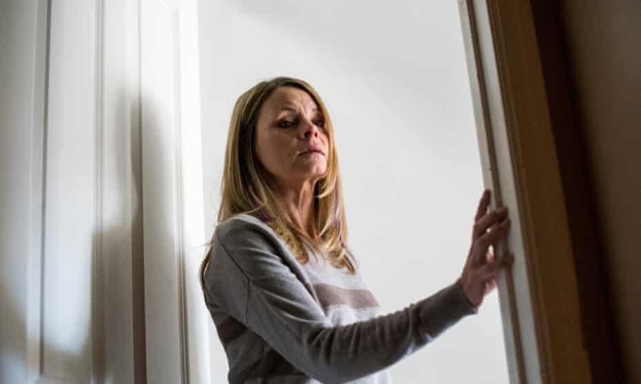 Kathleen Anduze, 55, reflects on her battle with Lewy Body Disease in the doorway of her bedroom in her Pleasant Valley, New York home. Kathleen was diagnosed with Lewy Body Disease, a form of progressive, degenerative dementia, at age 51.