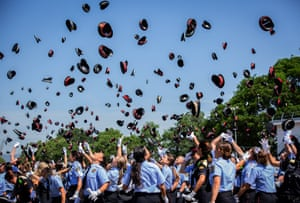 Graduates throw their caps in the air at the Catalan Institute for Public Security in Barcelona