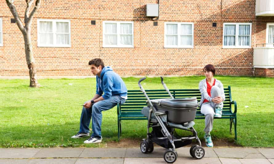 couple with pram outside flat