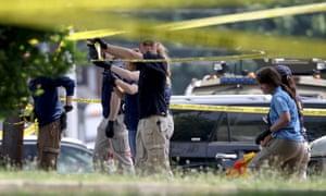 FBI investigators at the scene of the shooting on 14 June.
