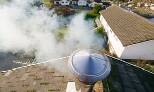 A household chimney emitting smoke