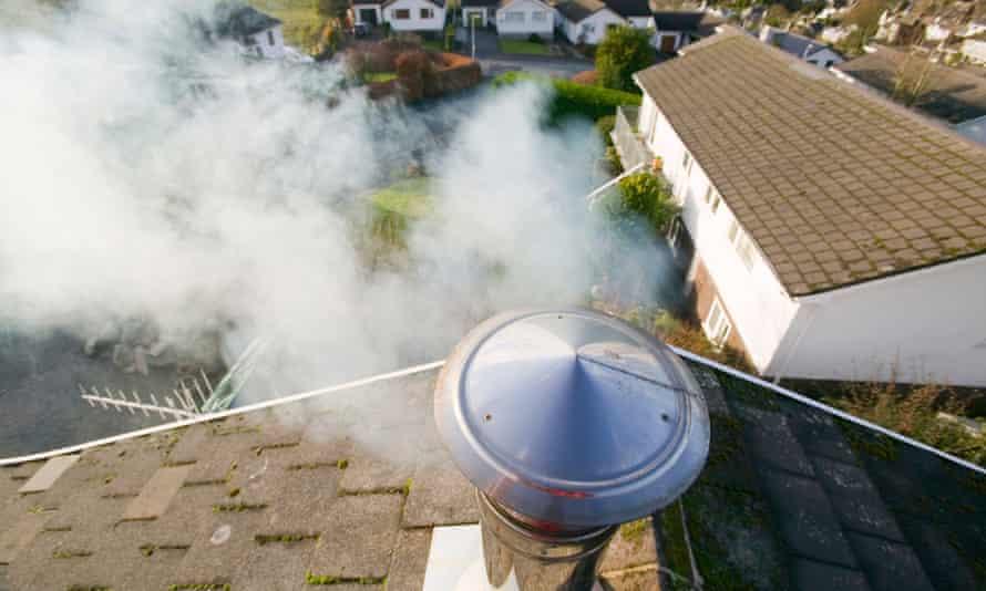 A household chimney emitting smoke