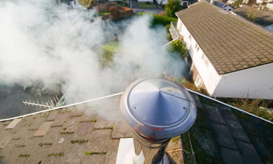 A household chimney emitting smoke.