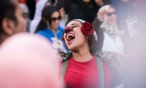 An artist performs during a demonstration against sexual harassment in Cairo.