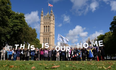 EU citizens holding up a banner after lobbying MPs to guarantee their post-Brexit rights at the Houses of Parliament in London.