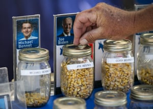 An attendee casts a corn kernel supporting former U.S. Vice President Joe Biden, 2020 Democratic presidential candidate, in a straw poll during the Iowa State Fair.