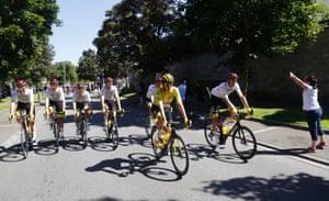 Slovenian rider Tadej Pogacar of UAE-Team Emirates is flanked by teammates en route to Paris.