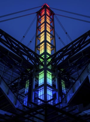 The RheinEnergieStadion in Cologne, Germany, is lit up in rainbow colors