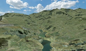 This oblique view of Snowdon shows OS MasterMap rendered with the height values from OS Terrain 5. This method is known as terrain draping. The background is OS MasterMap Imagery layer which has been moulded over the grid of heights from OS Terrain 5. Over the top of this we have added generalised tracks, paths, and selected roads from OS MasterMap Topography Layer. A combination of Esri ArcScene and Adobe Illustrator were used and a sky also added.