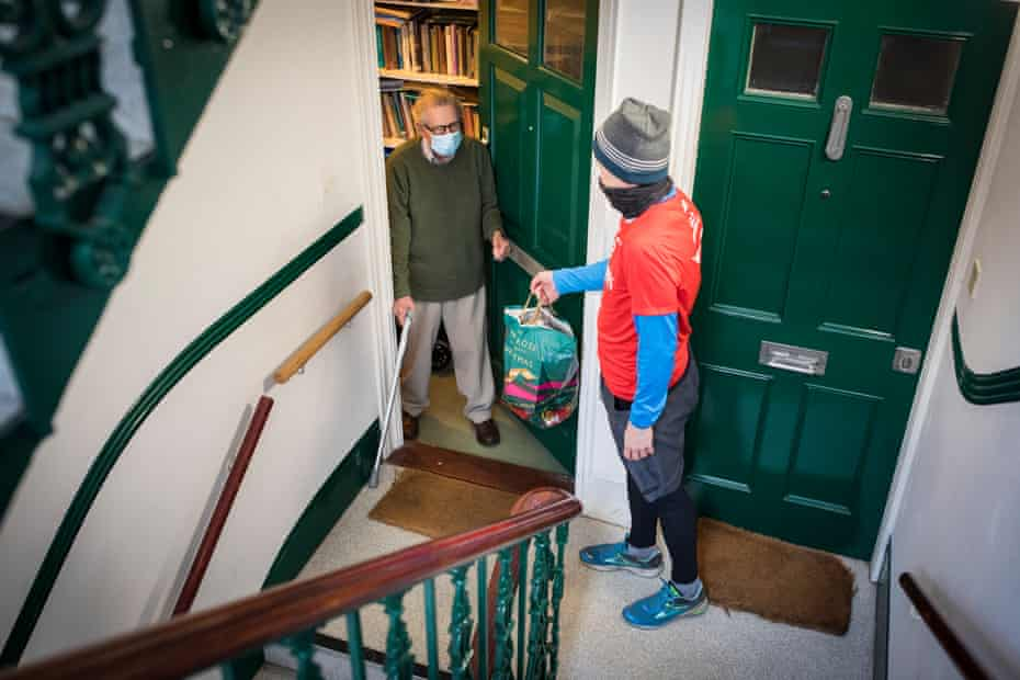 Nick Moore, 49, delivers shopping to Alan Spence, 94. He lives on the second floor in his block and cannot use the stairs