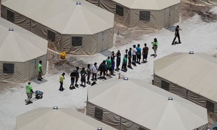 Children and workers at a tent encampment housing migrant children in Tornillo, Texas, on 19 June.