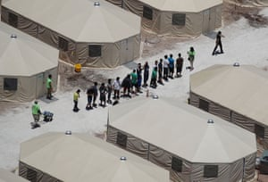 Children and workers are seen at a tent encampment near the Tornillo port of entry on 19 June 2018 in Tornillo, Texas
