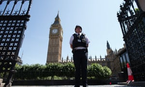A police officer stands in Parliament Square, London, as Britain remembers the victims of the Tunisia attack.