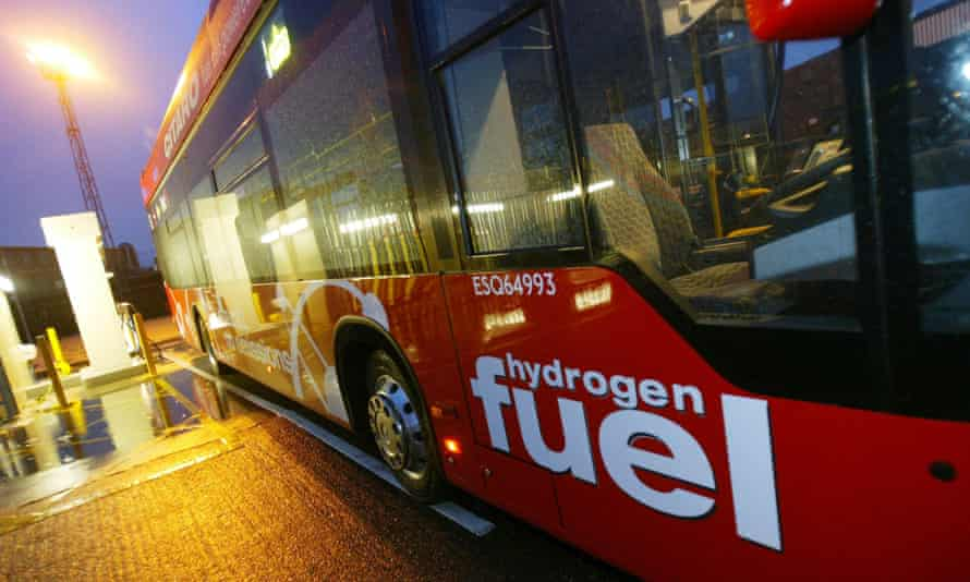 A hydrogen powered bus is refuelled at a depot in London.