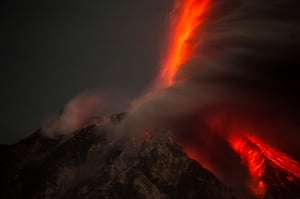 The eruptions from Mount Sinabung. The fast-moving waves of hot gas and rock can reach 700C as they roar down the sides of the volcano