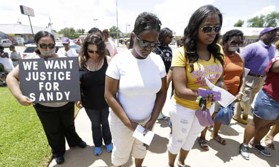 Protesters prayer at rally outside the Waller County Courthouse after a march from the Waller County Jail in July.