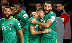 Tom Cleverley and Troy Deeney embrace after Cleverley scores to seal a comeback victory.