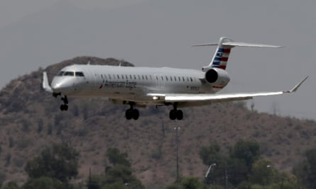 An American Eagle jet flies through heat ripples as it lands at Sky Harbor International Airport in Phoenix
