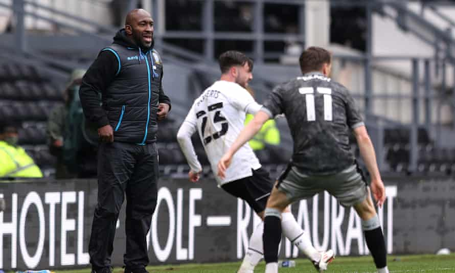 Sheffield Wednesday manager Darren Moore watches his team play Derby in May