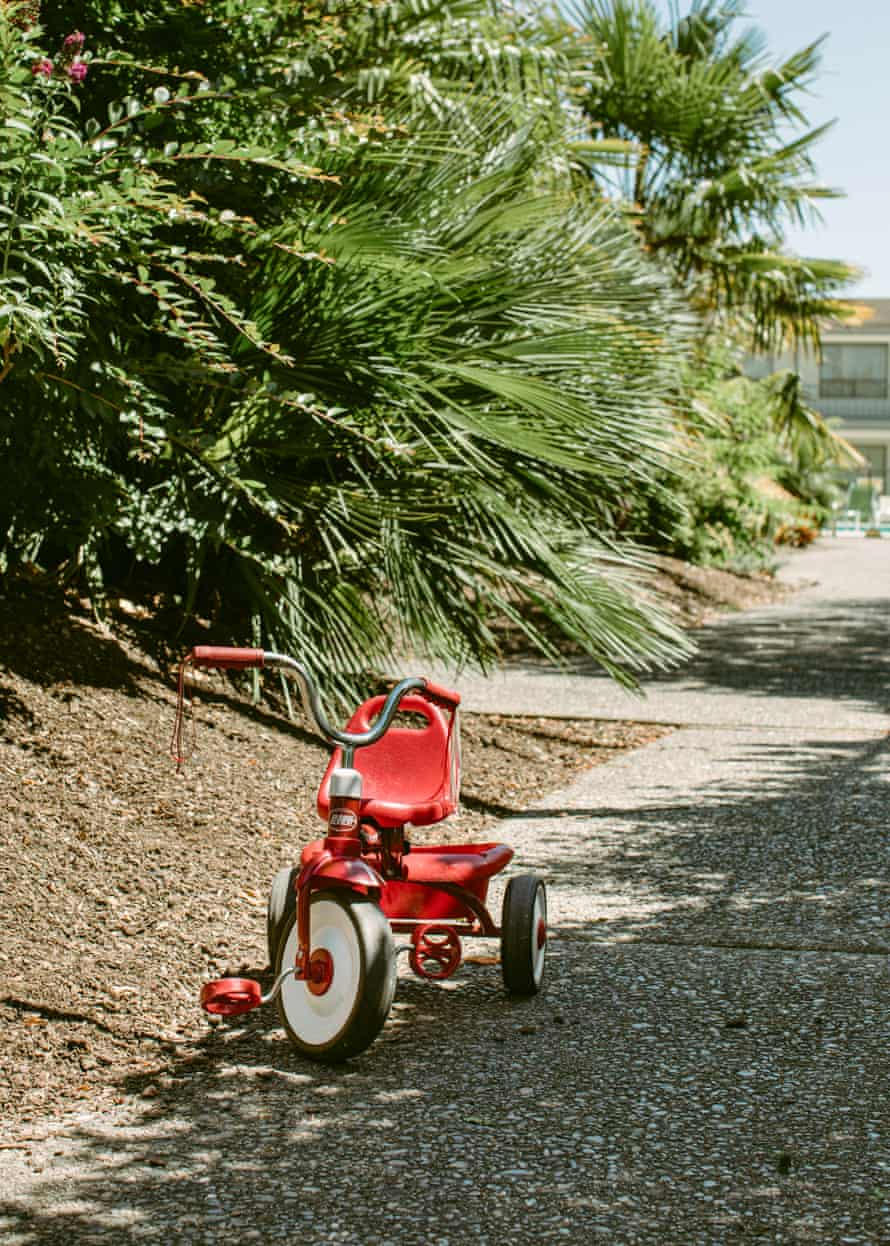 A tricycle sits outside hotel