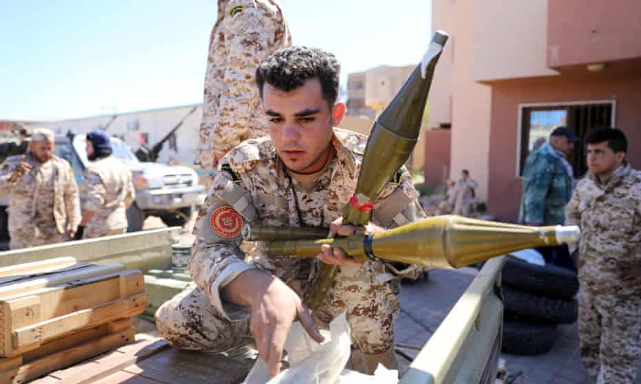 Members of Misrata forces, which have reinforced Tripoli's forces, prepare themselves to go to the front line.