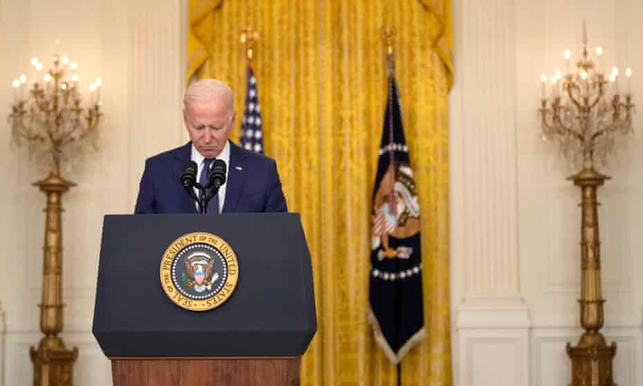 Joe Biden bows his head in a moment of silence as he speaks about the situation in Kabul from the East Room of the White House.