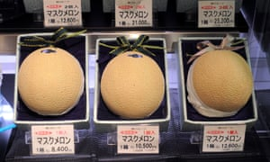 Gift boxes of flawless melons for sale at a food shop in Tokyo's trendy Shibuya district.