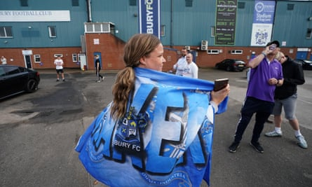 Supporters gather outside Gigg Lane after Bury's expulsion from the Football League in 2019. Bury AFC hope eventually to be able to buy back the ground.
