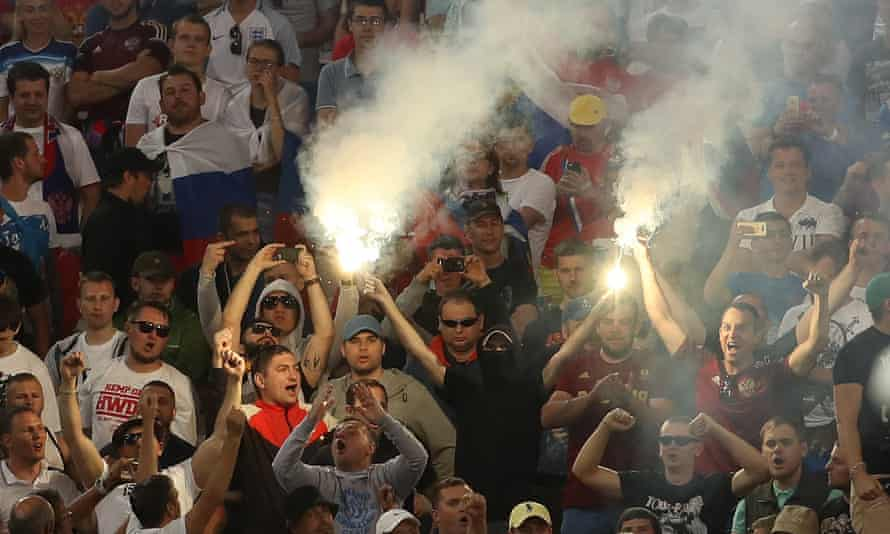Russia fans let off flares.