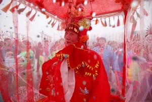 A performer in Beijing, China, dances during a folk art performance celebrating the Lantern festival, which marks the end of the new year celebrations