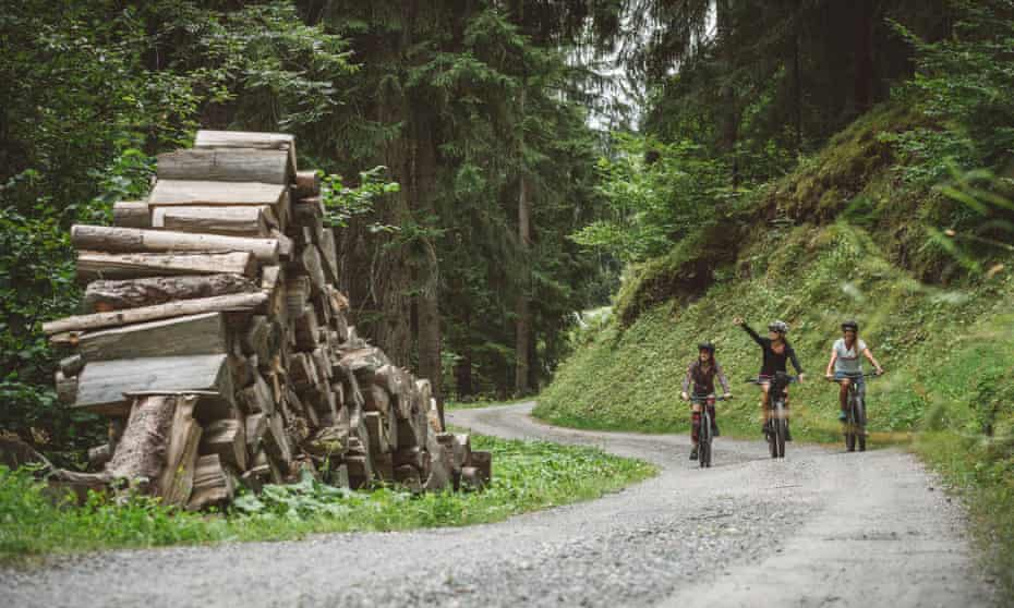 Three ebikers on a mountain road