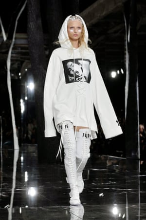 The oversized sporty top/swagger boots look Rihanna chose to open with.