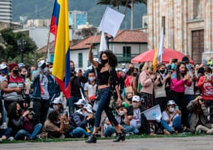 Bogotá, Colombia. A model presents a creation by former Farc combatants during a demonstration demanding peace, in Bolivar Square