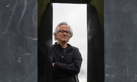 Anish Kapoor, seen next to one of his sculptures at Houghton Hall, says historic museums should recognise the legacy behind their collections