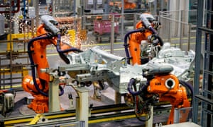 Robots work on the Mini production line at the BMW group plant in Cowley, near Oxford
