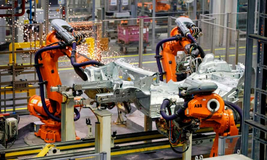 Robots assemble a Mini at the BMW plant in Cowley