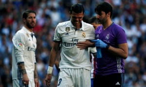 Pepe leaves the field after colliding with Toni Kroos.