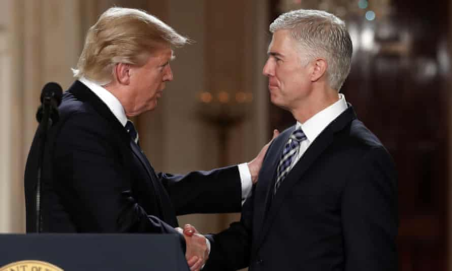 Donald Trump shakes hands with supreme court nominee Neil Gorsuch in the White House last month