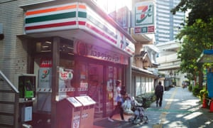 A customer leaves a 7-Eleven convenience store, in Tokyo japan