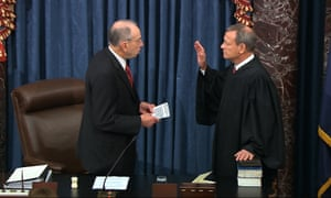 Senator Chuck Grassley swears in Supreme Court Chief Justice John Roberts as the presiding officer for the impeachment trial.