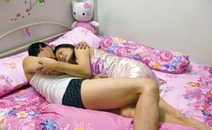 Aoy, from Bangkok, Thailand, lying on a bed, one of a series of self-portraits by people living with HIV