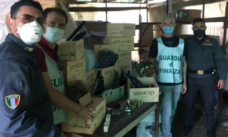 Police with the haul of counterfeit Tuscan wine