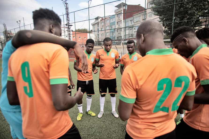 Footballers pray for success before a match