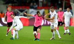 Scotland's James McArthur shields the ball from Slovakia's Milan Skriniar.