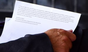 The papers photographed in the hand of a civil servant walking along Downing Street