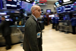 Traders work on the floor of the NYSE in New York tonight