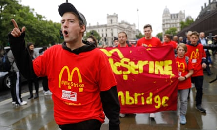 Demonstrators protest in London over working conditions and zero-hour contracts at McDonald's.