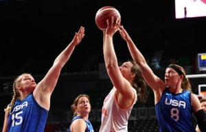 Rose Hollermann of the United States and Natalie Schneider of the United States in action with Mariska Beijer of the Netherlands.