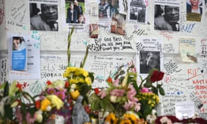 A memorial wall to the Grenfell Tower victims